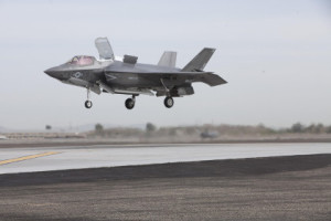 An F-35B Lightning II from Marine Fighter Attack Squadron 121 conducts a vertical landing on the Marine Corps Air Station Yuma, Ariz. flightline March 21, 2013. BF-19, piloted by Maj. Richard Rusnok, an F-35B test pilot, marked an important milestone in the evolution of the aircraft conducting the first short take off, vertical landing outside of a testing environment. (Photo by Staff Sgt Jessica Smith)