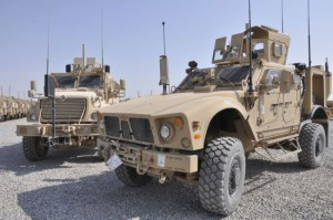 608232_An-MATV-Mine-Resistant-Ambush-Protected-vehicle-parked-next-to-a-MaxxPro-MRAP