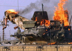 British soldier jumps from burning tank in southern Iraq city of Basra.